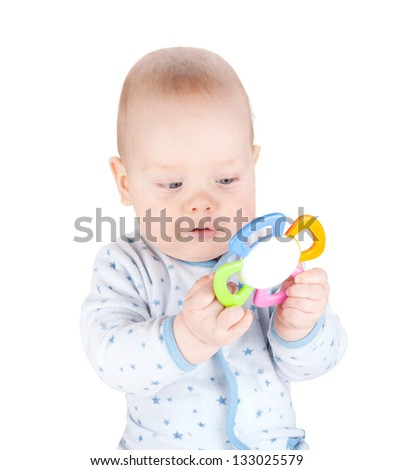 Cute baby boy is holding toy. Isolated on white background