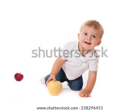 Cute baby boy kid playing with apples isolated on white background - stock photo