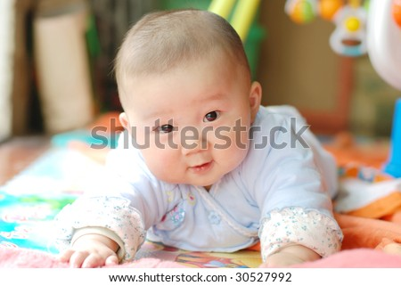cute baby boy looking at you - stock photo