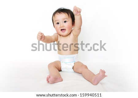 Cute baby boy looking straight with curiosity - stock photo