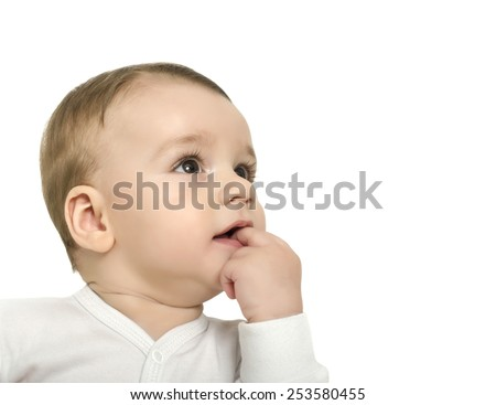 Cute baby boy looking up surprised. Baby with hand in the month looking curious. Isolated on white. - stock photo