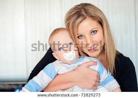 Cute baby boy 6 months old with mother - stock photo