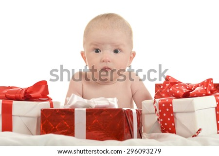 Cute baby boy sitting  with gifts on a white background - stock photo