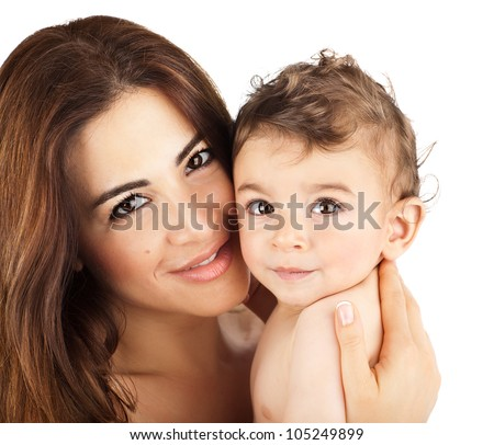 Cute baby boy smiling with mother, closeup on happy family faces, mom and kid having fun indoor, parent holding little child in hands, healthy toddler and mommy portrait isolated on white background - stock photo