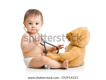 cute baby boy weared diaper with stethoscope and toy - stock photo