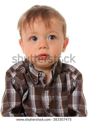 Cute baby boy wearing a plaid shirt.  - stock photo