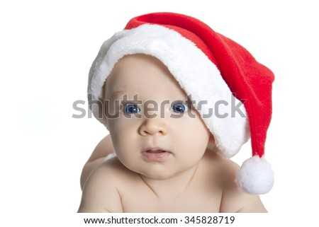 cute baby boy wearing christmas cap, beautiful funny infant in Santa's hat
