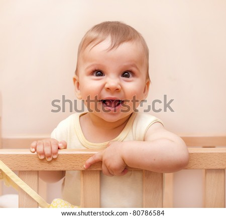Cute baby boy with adorable smile portrait - stock photo