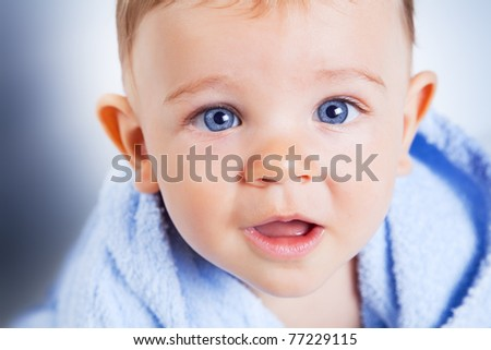 Cute baby boy with big blue eyes
