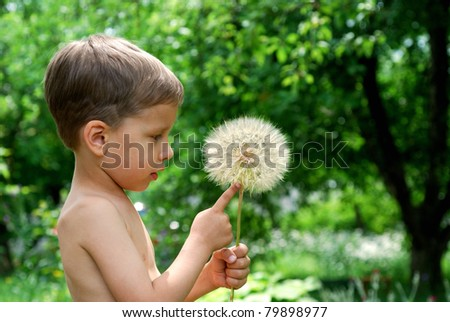 Cute baby boy with dandelion flower