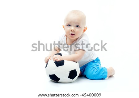 cute baby boy with fottball over white
