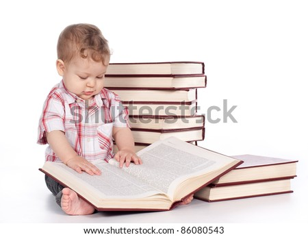 cute baby boy with many books isolated on white background - stock photo