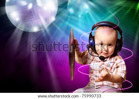Cute baby dj in disco - stock photo