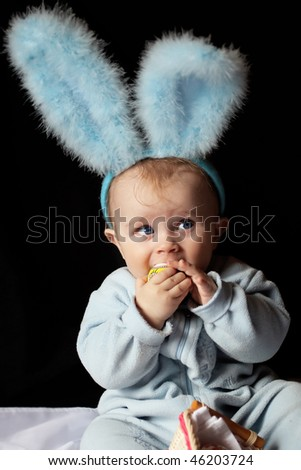 cute baby dressed as a bunny - stock photo