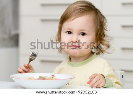 Cute baby eating - stock photo