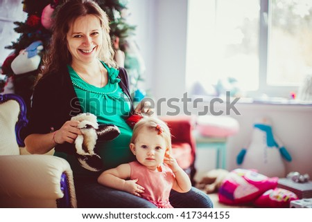 Cute baby girl and her happy mother - stock photo