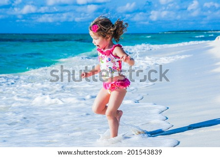 Cute baby girl at the ocean - stock photo