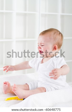 Cute baby girl crying - stock photo