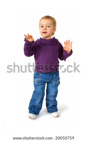 Cute baby girl dancing with hands up