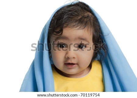 Cute Baby Girl Draped in Blue Blanket, Isolated, White - stock photo