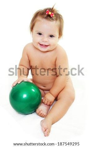 cute baby girl holding green ball over white background