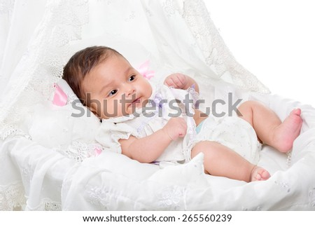 Cute baby girl in a basket - stock photo
