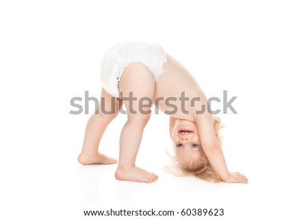 cute baby girl in diaper wants to turn somersaults isolated on white