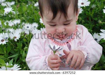 cute baby girl in garden - stock photo