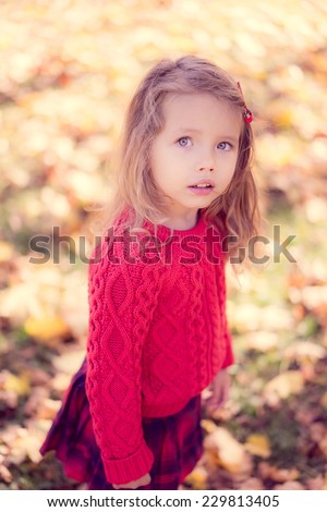 Cute baby girl in the autumn forest