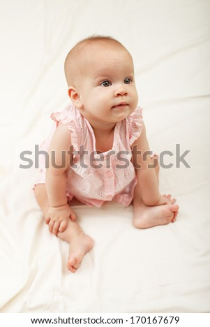 Cute baby girl looking away