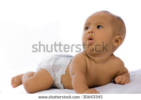 Cute baby girl lying on white background