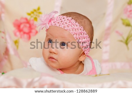 Cute Baby girl on flower blanket - stock photo