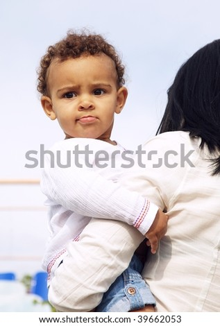 cute baby girl on her mother`s arms - stock photo