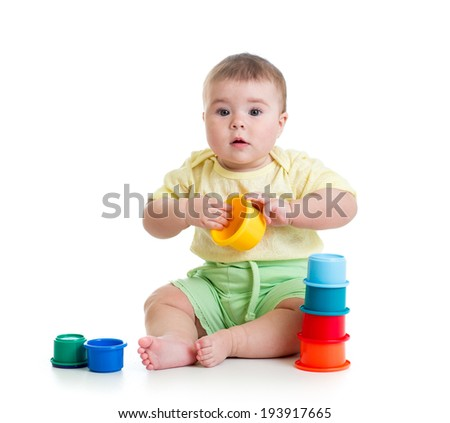 Cute baby girl playing with toys - stock photo