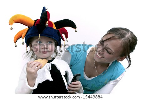 Cute baby girl posing in clown hat with mommy