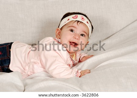 cute baby girl smiling - stock photo