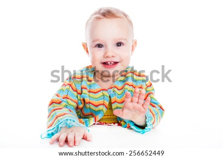 Cute baby girl smiling on white backdrop - stock photo