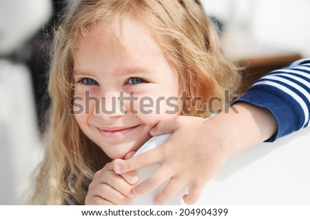 Cute baby girl smiling outdoors - stock photo