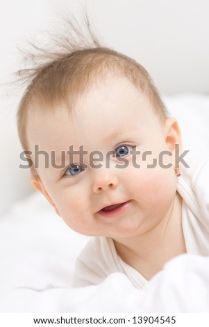 Cute baby girl smiling, white background. - stock photo