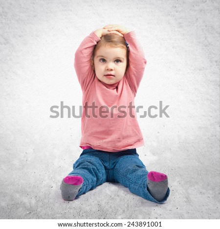 Cute baby girl surprised over textured background - stock photo