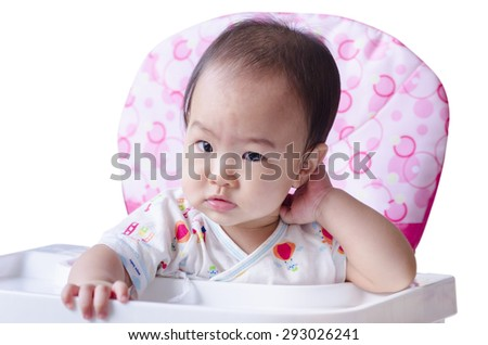 Cute baby girl waiting for breakfast - stock photo