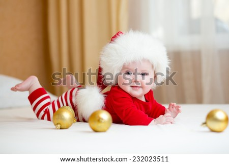 Cute Baby girl weared Christmas clothes at home - stock photo
