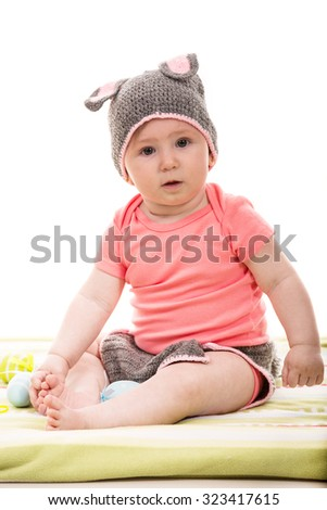 Cute baby girl wearing croched bunny hat - stock photo