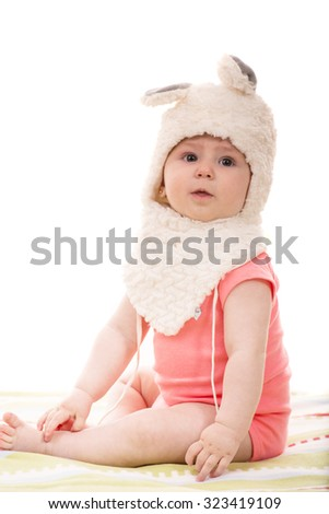 Cute baby girl wearing fluffy bunny hat isolated on white background