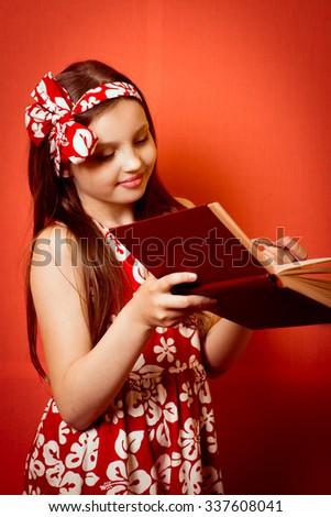 Cute baby girl with a book, learning - stock photo