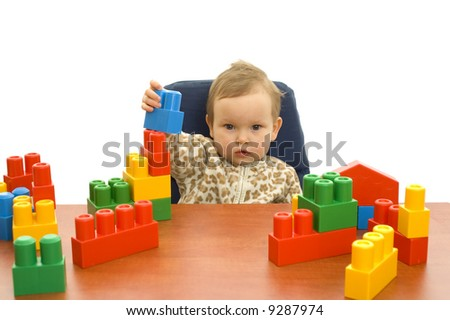 Cute baby girl with colorful blocks isolated background