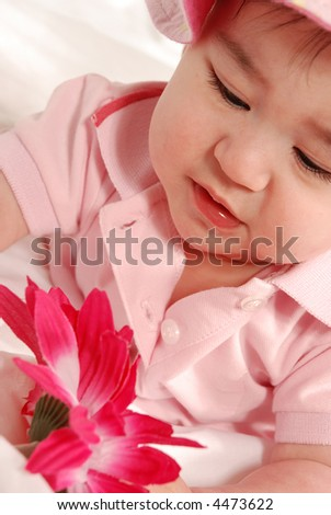cute baby girl with pink flower - stock photo