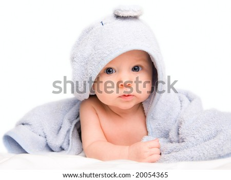 Cute baby girl with towel after bath. Studio shot. Isolated on white - stock photo