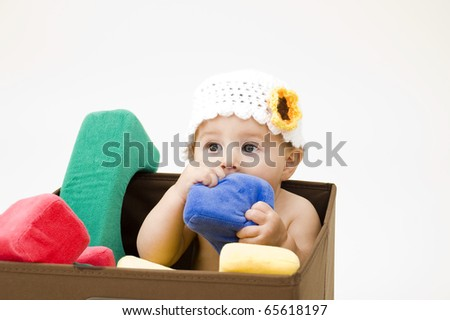 Cute Baby Girl with Toys Against White Background.