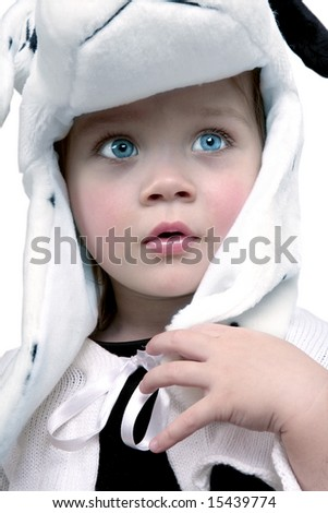 Cute baby girl with white hat looking up - stock photo